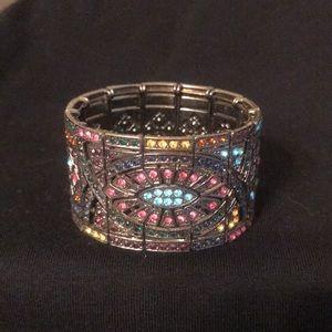 Bracelet tiny shiny stones in a pattern .